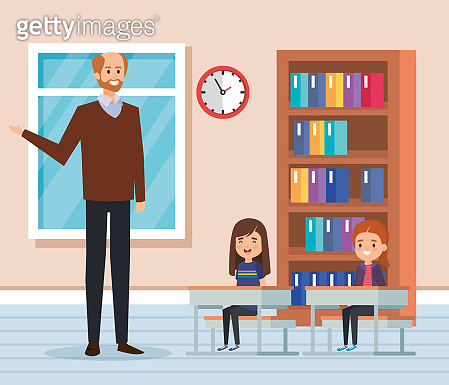 man teacher with kids in the classroom and bookcase