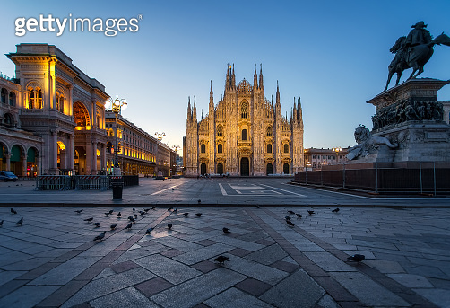 Milan Piazza del Duomo square. City center illuminated in the dusk. Milano, Italy
