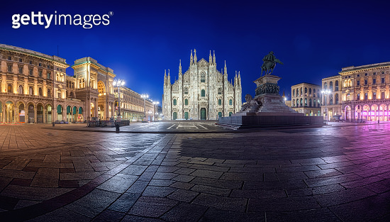 Milan Piazza del Duomo square. City center illuminated at night. Milano, Italy