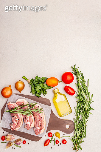Raw pork belly with rind, peritoneum meat. Fresh tomato cherry, rosemary, spice