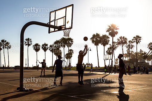 Young Adult Playing Basketball at Venice Beach, Santa Monica, California