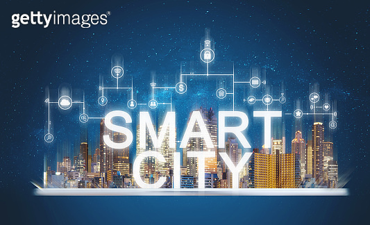 Smart city and building technology. Augmented reality buildings with online media and network application icons on digital tablet