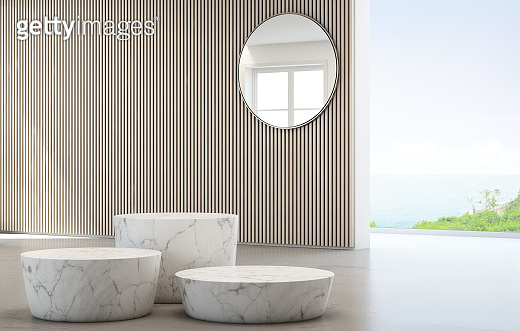 Sea view dressing room of luxury summer beach house with glass window and white marble podiums. Empty wooden wall background in studio or showroom.