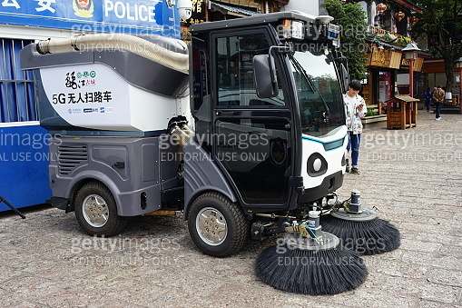 5G sweeping machine at the street.