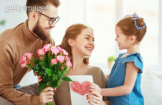 happy mother's day! father and child congratulate mother on holiday