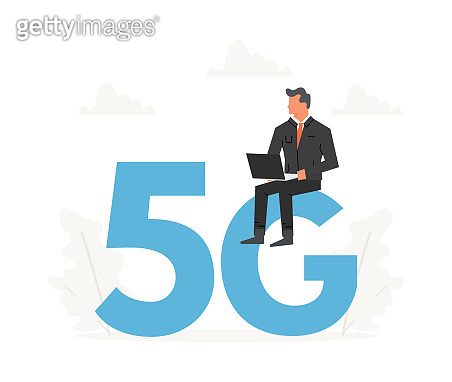 Businessman with laptop sitting on a big letters 5G. Fifth generation network wireless, internet technology