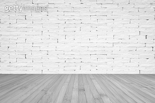 Grunge old aged brick wall painted in white color with wooden floor textured background in light grey with vignette