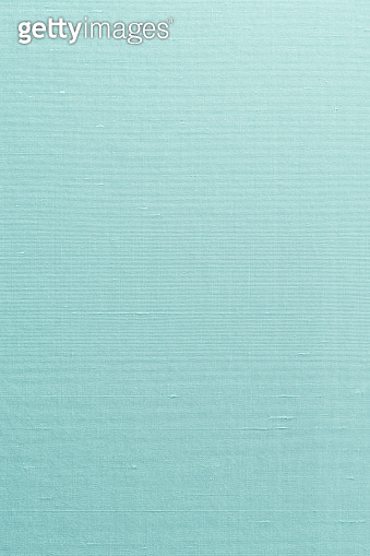 Silk cotton linen blended fabric textile texture background in light cyan blue turquoise aqua green