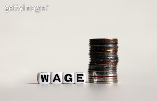 'WAGE' text in white cube and a pile of coins.