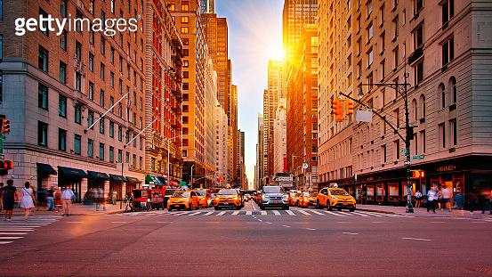 New York Avenue. Street. Sun. Yellow Taxi. Conceptual Famous View