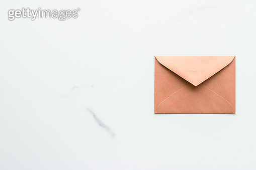 Blank paper envelopes on marble flatlay background, holiday mail letter or post card message design