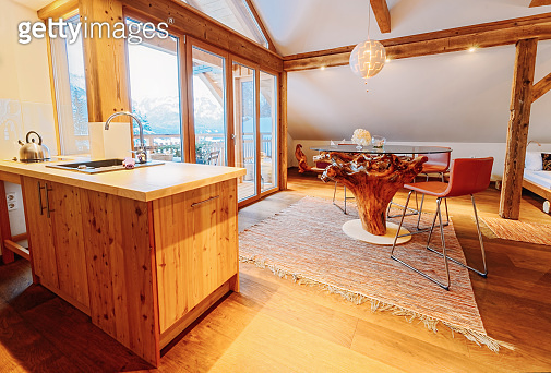 Interior of contemporary wooden living room with kitchen