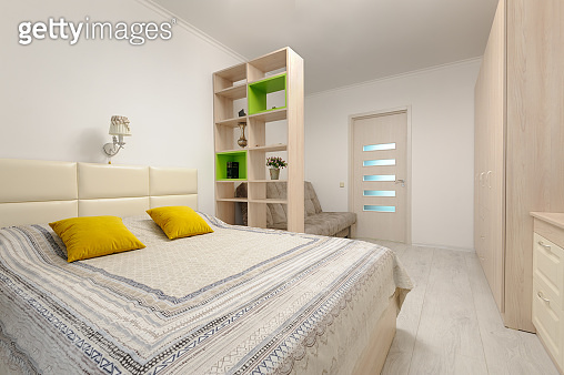 Bedroom interior with large double bed