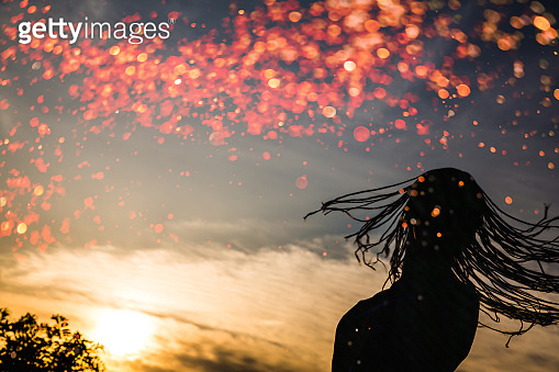Silhouette of braided hair teenage girl turning around