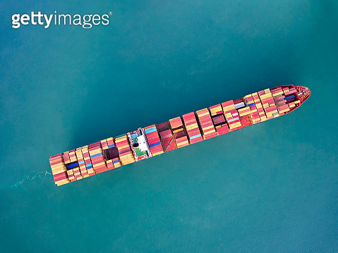 Aerial view of freight ship with cargo containers at sea in Bosphorus