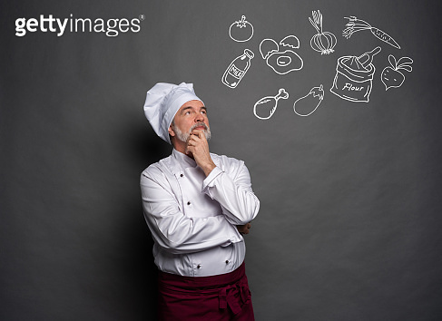 Image of chef planing what to cook on gray background.Chef thinking.