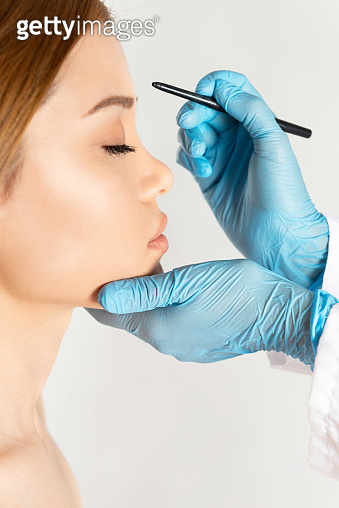 Cosmetic Surgeon Drawing Marks On Face