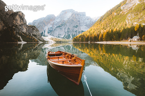 Traditional rowing boat on a lake in the Alps in fall