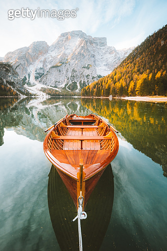 Traditional rowing boat at Lago di Braies at sunrise in fall, South Tyrol, Italy