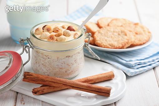 Overnight oats with cinnamon, nuts, yogurt, and oatmeal cookies