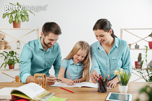 Young happy family are spending time together. A day in lovely home.