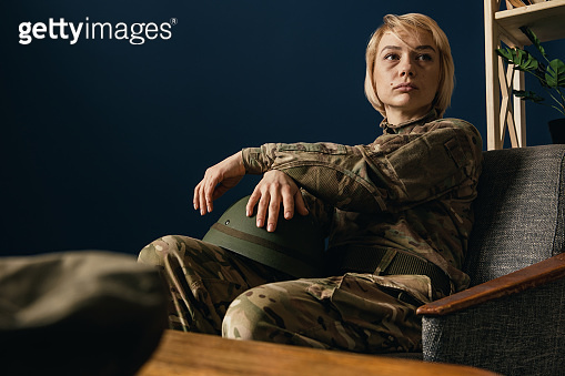 Portrait of young female soldier
