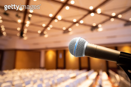 Microphone stand abstract blurred photo in conference hall or seminar room background, no people,
