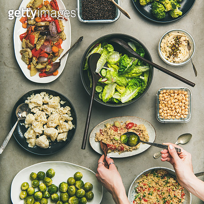 Healthy vegan dishes and woman hands taking couscous, squqre crop