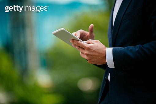 Handsome businessman using tablet