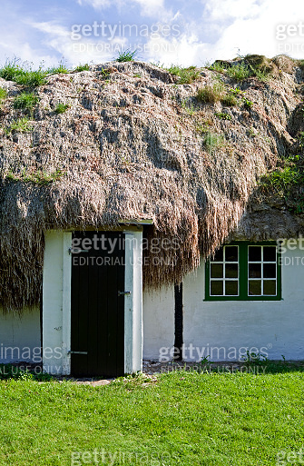 Denmark: Old half-timbered cottage with seaweed roof