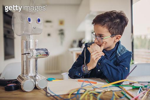 Smart boy constructing a robot