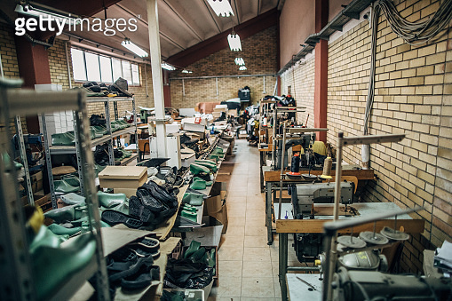 Shelves full of shoes in shoe factory