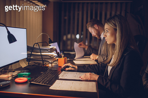 Business woman and businessman working late in the office