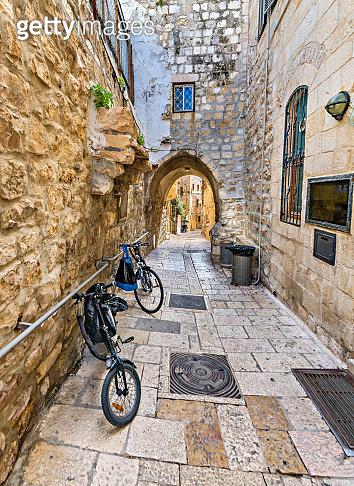 Ancient narrow street in old city of Jerusalem, Israel