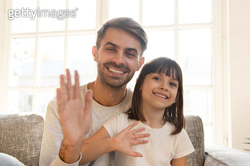 Happy child girl and father wave hands record vlog