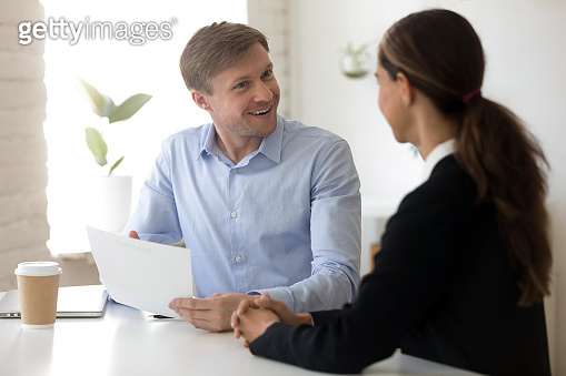 Funny employer and applicant laughing during successful job interview