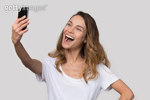 Headshot portrait attractive laughing female make selfie photo
