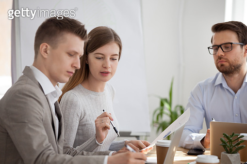 Serious employees talk collaborating at business meeting