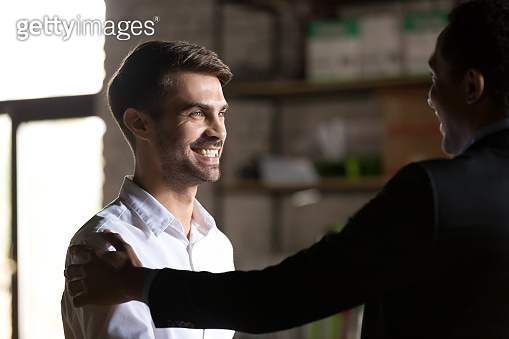 Boss congratulating employee with job promotion and good work results