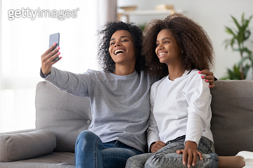 Happy mother and daughter make selfie together