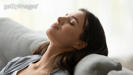 Beautiful healthy young woman taking deep breath of fresh air