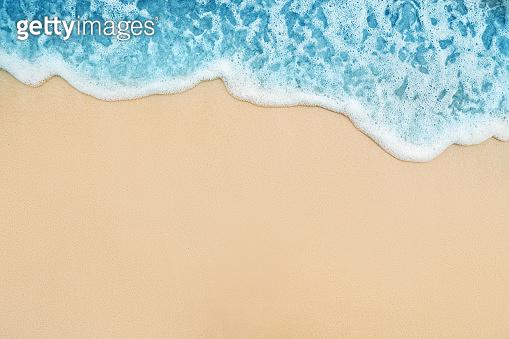 Background of Soft Blue Ocean Wave On Sandy Beach.