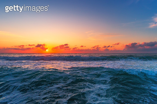 Beautiful sunset over the tropical sea waves