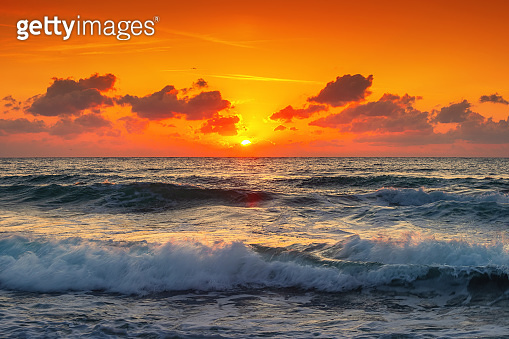 Beautiful sunset over the tropical sea. Cloudscape and exotic beach