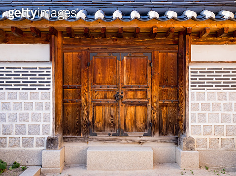 Traditional korean architecture, stone wall with wooden door in Gyeongbokgung Palace, Seoul, South Korea.