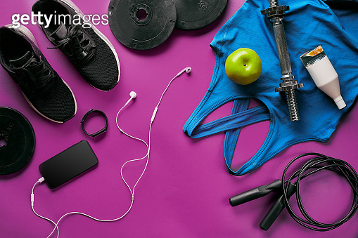 Fitness female outfit background top view. Set of sport clothing and equipment for women, active lifestyle
