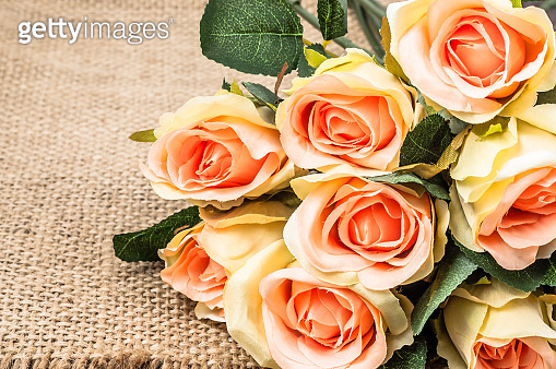 Roses bouquet. Flowers on rustic background useful as mother's day card.