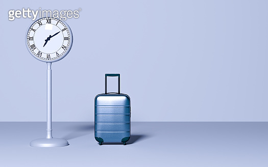 Street clock and travel baggage on pastel background.