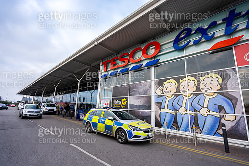 A police vehicle outside the large Tesco Extra store, shop in Stoke on Trent, attending because of theft