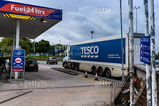 A Tesco lorry heads past the Petrol Station in Stoke on Trent, Staffordshire